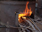 Burning wood stove — Stock Photo
