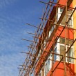 Стоковое фото: Scaffold in construction site
