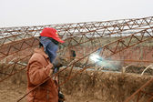 A worker Welding vegetable greenhouses, china — Stock Photo