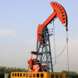 Oil pumping unit in working — Stock Photo #22000477