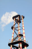 Chimney in an industrial enterprise — Stock Photo