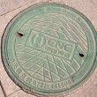 City manhole covers - Stock Photo