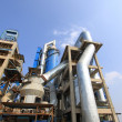 Giant mechanical facilities in cement factory — Stock Photo #24151429