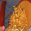 Stock Photo: Buddism godness Guanyin statue in hall in temple