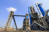 Giant mechanical facilities in a cement factory — Stock Photo