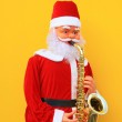 Santa Claus is playing Sax — Stock Photo
