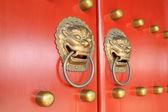 Metal Knocker on the door in the Forbidden City in Beijing, chin — Stock Photo