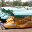 Стоковое фото: Rows of small boat in water in park