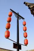 Red lantern on the eaves in a temple — Stock Photo