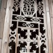 Carved window frames in the Phoenix Town - Stock Photo