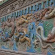 Chinese Ancient dragon relief sculpture make by Colorful Glazed — Stock Photo #24631679