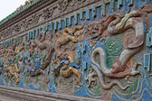 Chinese Ancient dragon relief sculpture make by Colorful Glazed — Stock Photo