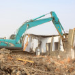 Stock Photo: Excavator in the construction debris clean up site