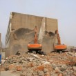 Excavator in the construction debris clean up site — Stock Photo #25823829