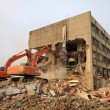 Excavator in the construction debris clean up site — Stock Photo #25823839