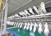 Acrylonitrile butadiene gloves production line in a factory, nor — Foto Stock