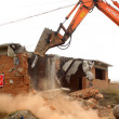 Stock Photo: Tractors pulling down bad house