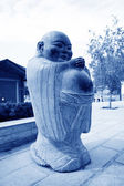 Figure of Buddha belly in a park in a temple — Stock Photo