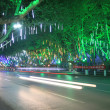 Vehicles and light, trees in the modern city, in the night — Stock Photo