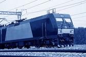 Locomotive running on railway — Stock Photo