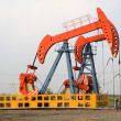 Oil pumping unit in working — Stock Photo