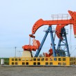 Stock Photo: Oil pumping unit in working