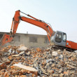 Excavator in the construction debris clean up site — Stock Photo #32315097