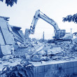 Excavator in the construction debris clean up site — Stock Photo