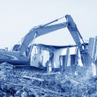 Excavator in the construction debris clean up site — Stock Photo #32315401
