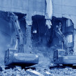 Excavator in the construction debris clean up site — Stock Photo #32315731