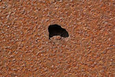 Hole on the iron plate — Stock Photo