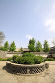 Chinese traditional architectural and greening in a park — Stock Photo