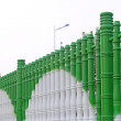 Stock Photo: Cylindrical fence wall