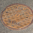 Rusty metal manhole covers in the streets of Beijing — Stock Photo