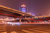 Night scene of the prosperous city, under the viaduct in beijing — Stock Photo