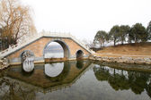 Chinese traditional style stone bridge in the snow — Stock Photo