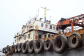 Ship's rail on the tyres — Stock Photo