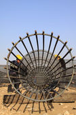 Reinforced component at the construction site and workers — Stock Photo