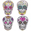 Mexican skull set. Colorful skulls with flower and heart — Stock Vector