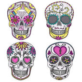 Mexican skull set. Colorful skulls with flower and heart — Vecteur
