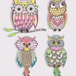 Stok Vektör: Set of cute colorful owls