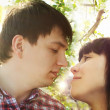 closeup portrait of young couple looking at each other — Stock Photo