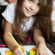 Portrait of lovely girl drawing a picture — Stock Photo