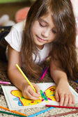 Lovely girl drawing a picture — Stock Photo