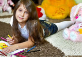 Pretty little girl drawing on a floor — Stock Photo