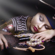 Woman pirate sleeping  with a bottle - Stok fotoğraf