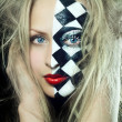 Closeup of woman with chess pattern on face — Stock Photo #22154799