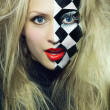 Closeup of model with chess pattern on her face — Stock Photo #22155185