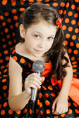 Little girl in orange peas dress — Stock Photo