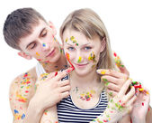 Closeup young woman and man drawing paints — Stock Photo